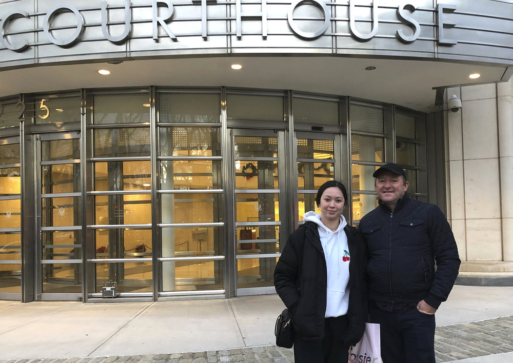 "In this Dec. 3, 2018 photo, Australian tourists Wayne and Lydia stand in front of Brooklyn's federal courthouse in New York, where they were attending the trial of Mexican drug trafficker Joaquin ""El Chapo"" Guzman. Burg is a criminal lawyer in his home country and said he did not want to miss the chance to witness one day in the trial of ""El Chapo."" AP Photo/Claudia Torrens."