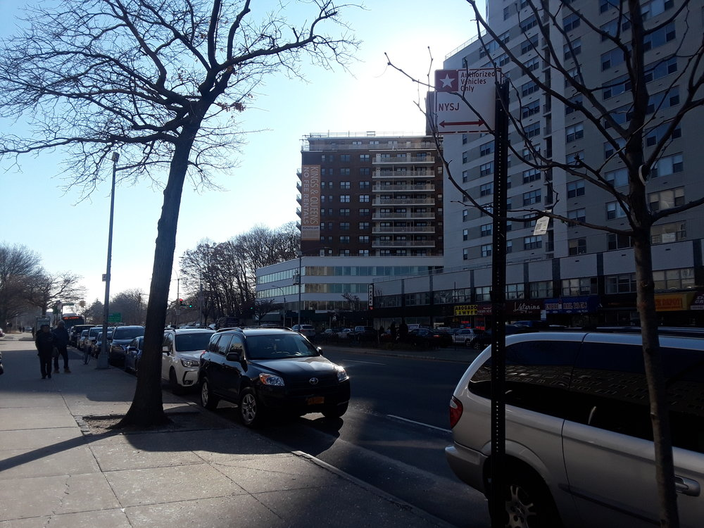 Cars parked in NYP Parking Zones in front of 125-01 Queens Blvd. on Dec. 11.  Eagle  photos by Christina Carrega.
