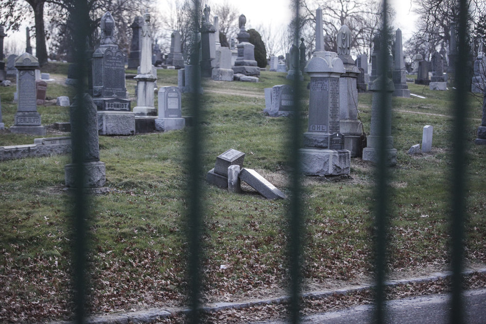 A broken monument at All Faiths Cemetery.