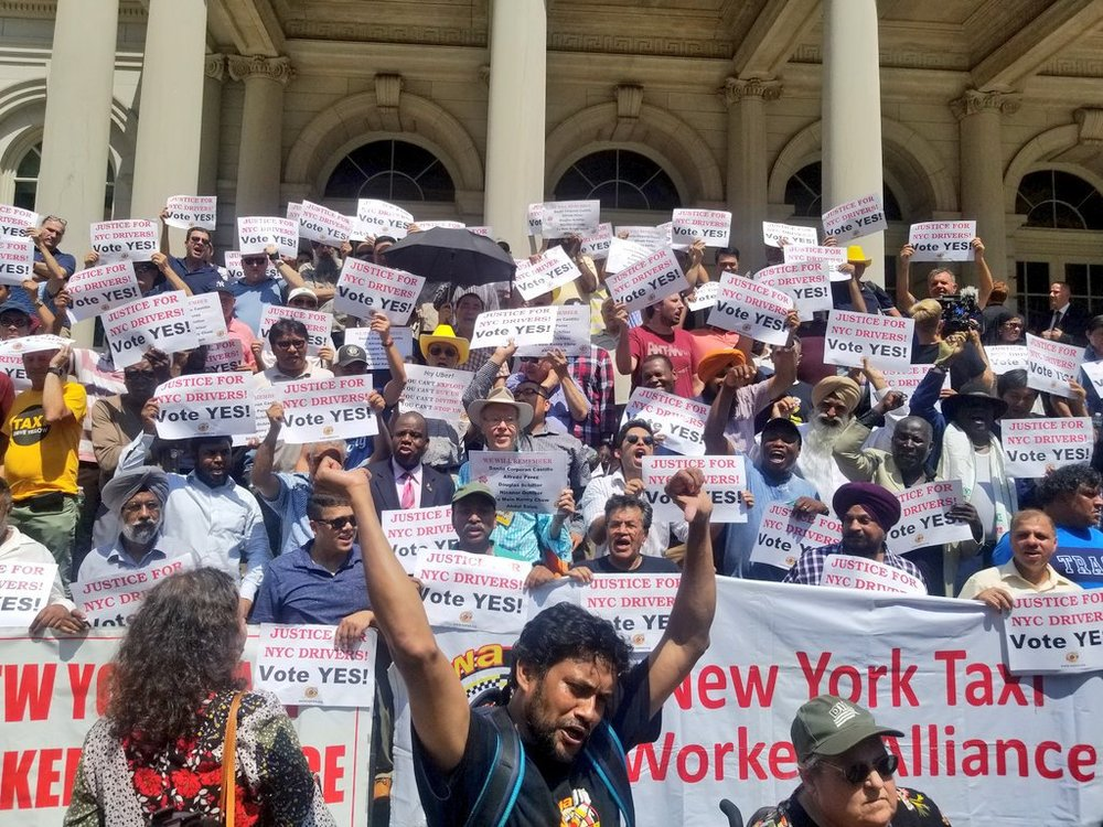 Members of the New York Taxi Workers Alliance demonstrate outside New York City Hall. Photo by Nick Gulotta via Law at the Margins.