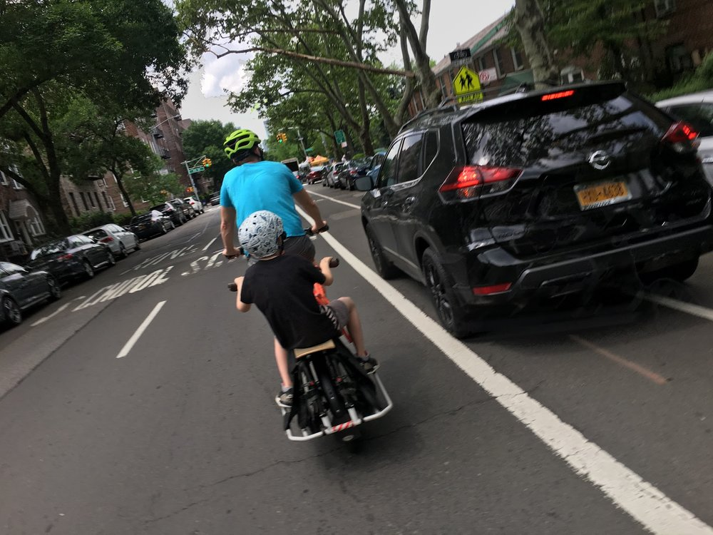 Safety advocates continue to call on the city to establish parking protected bike lanes to separate cyclists from cars and to prevent cyclist deaths. Photo by Cybele Grandjean.