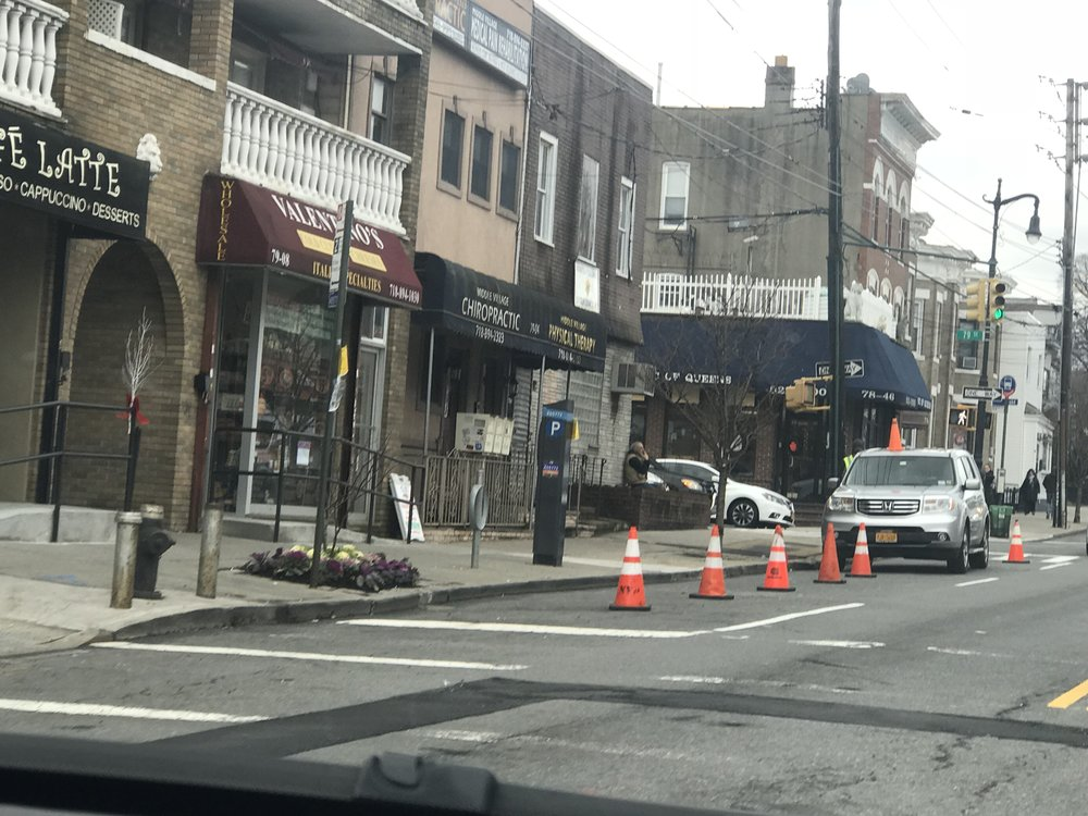A film production crew reserves coveted parking spots along Metropolitan Avenue in Maspeth. Photo courtesy of Robert Holden's office.