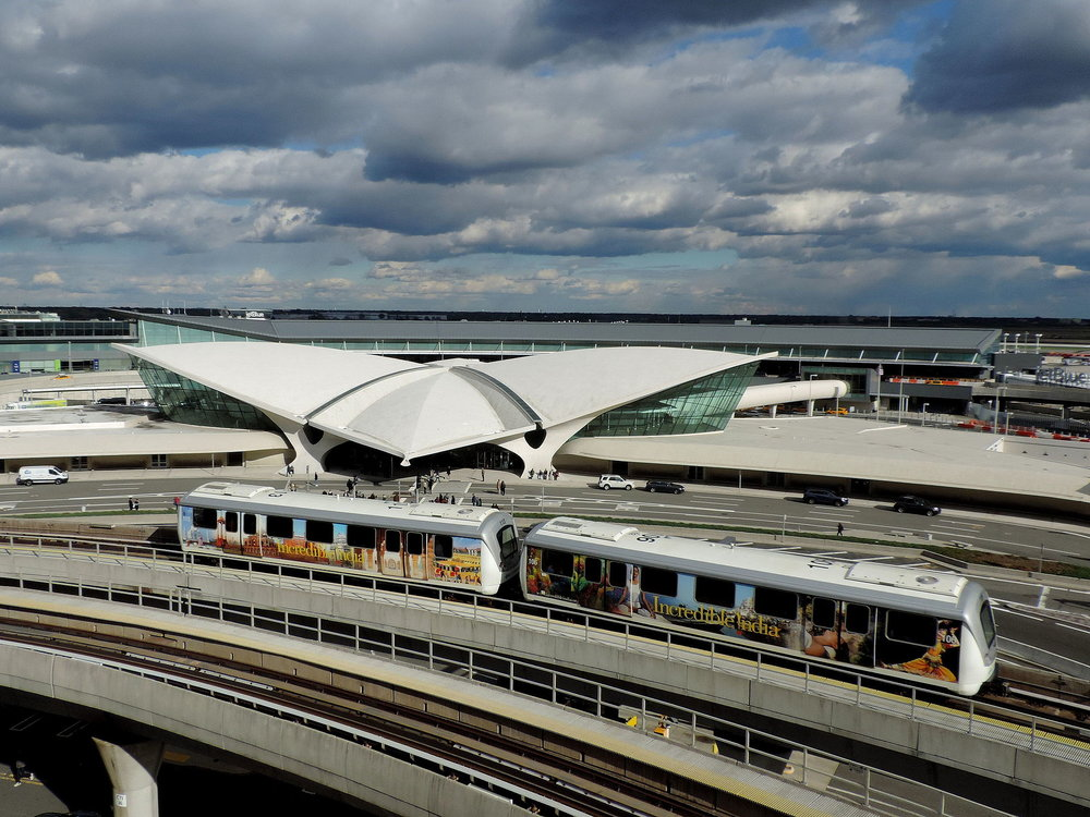 The JFK AirTrain Passes the TWA Flight Center. Photo by Jim.Henderson for Wikimedia Commons.