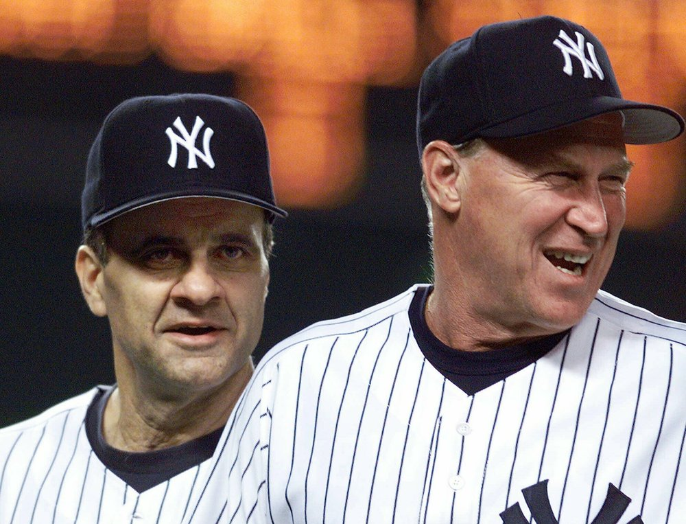 New York Yankees manager Joe Torre (left) and pitching coach Mel Stottlemyre head onto the field to congratulate their players after the Yankees defeated the Seattle Mariners 8-0 in New York in April 1999. Stottlemyre and Torre both coached in the Mets organization. The Yankees said Stottlemyre died Sunday, Jan. 13, 2019. AP Photo/Mark Lennihan, File