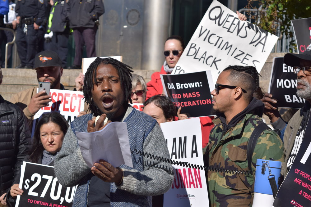 Ramel Edwards from the Bronx Freedom Fund speaks during a demonstration outside Queens Criminal Courthouse Tuesday.  Eagle  photo by Christina Carrega