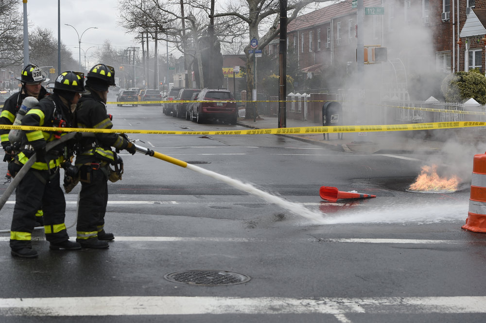 FDNY firefighters extinguish a manhole fire. Eagle photo by Todd Maisel.
