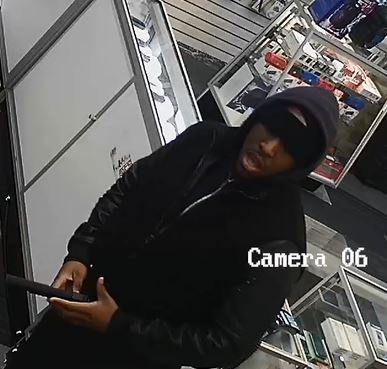 The armed suspect who allegedly robbed a store on Rockaway Boulevard on Jan. 19. Photo courtesy of the NYPD.