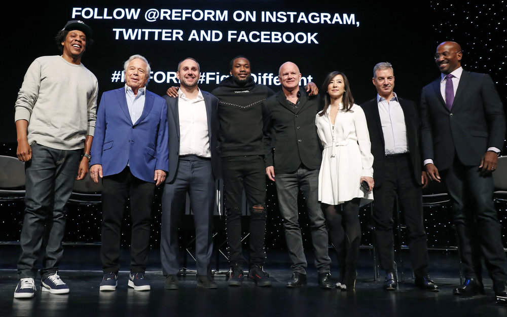"Business mogul, entrepreneur and recording artist Shawn ""Jay-Z"" Carter (left) poses with, from left, New England Patriots owner Robert Kraft, Philadelphia 76ers co-owner and Fanatics executive chairman Michael Rubin, recording artist Meek Mill, Galaxy Digital CEO and founder Michael Novogratz, Brooklyn Nets co-owner Clara Wu Tsai, Third Point CEO and founder Daniel S. Loeb and REFORM Alliance CEO and political activist Van Jones after the group announced the launch of a partnership to transform the American criminal justice system on Wednesday. AP Photo/Kathy Willens."