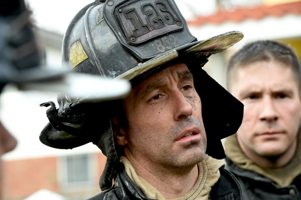Firefighter Terry McSweeney pulled a woman from the second-floor bathroom, but she did not survive the blaze.