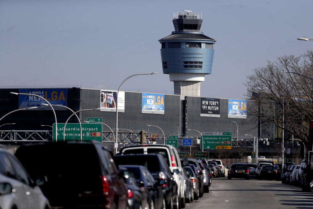 "The air traffic control tower at LaGuardia Airport is pictured here on Friday. The Federal Aviation Administration reported delays in air travel Friday because of a ""slight increase in sick leave"" at two East Coast air traffic control facilities. AP Photo/Julio Cortez."
