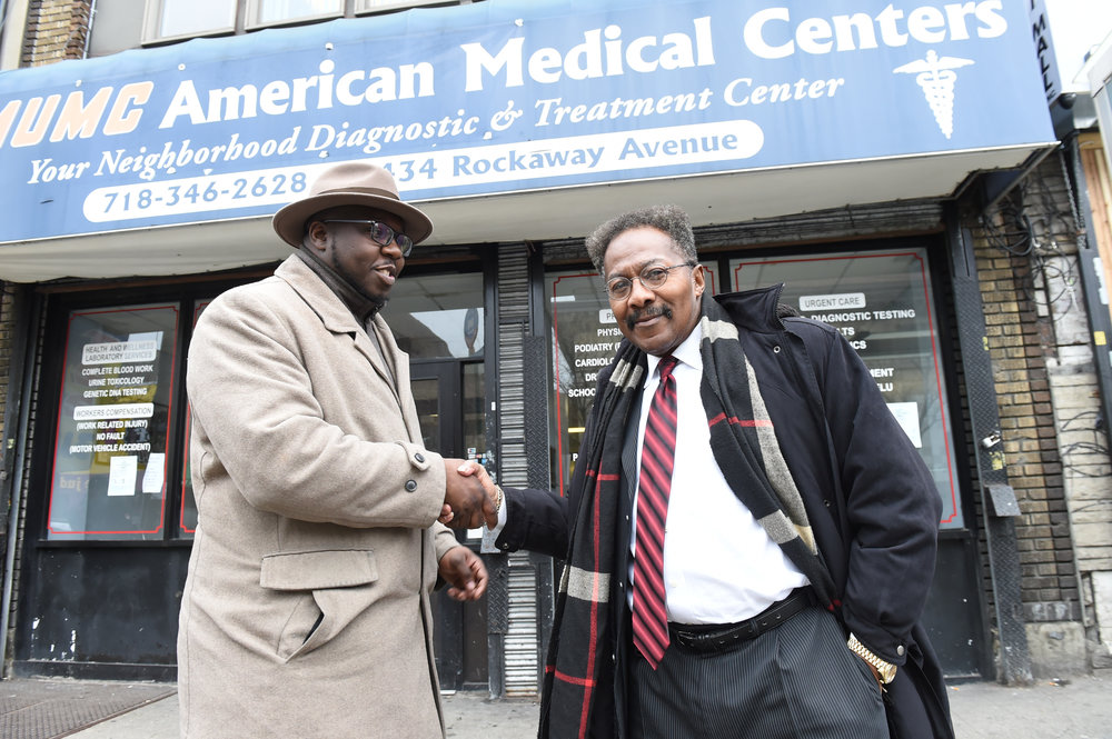 Rev. Kevin McCall (left) is joined by Tony Brown-Arkah, CEO of AMUMC American Medical Centers on Rockaway Avenue (right) as Brown donates space for feeding the homeless and federal workers who may be shut out in a government shut down in the future.  Eagle  photos by Todd Maisel