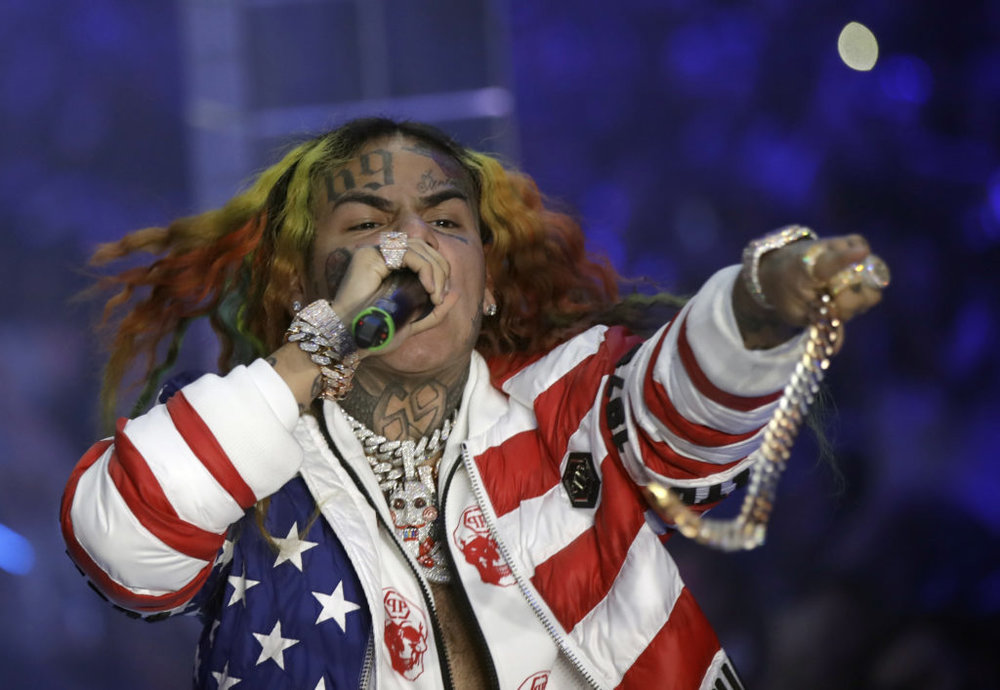 Rapper Tekashi 6ix9ine has admitted to joining a violent gang in New York city and is pleading guilty to multiple felonies.AP Photo/Luca Bruno, File.