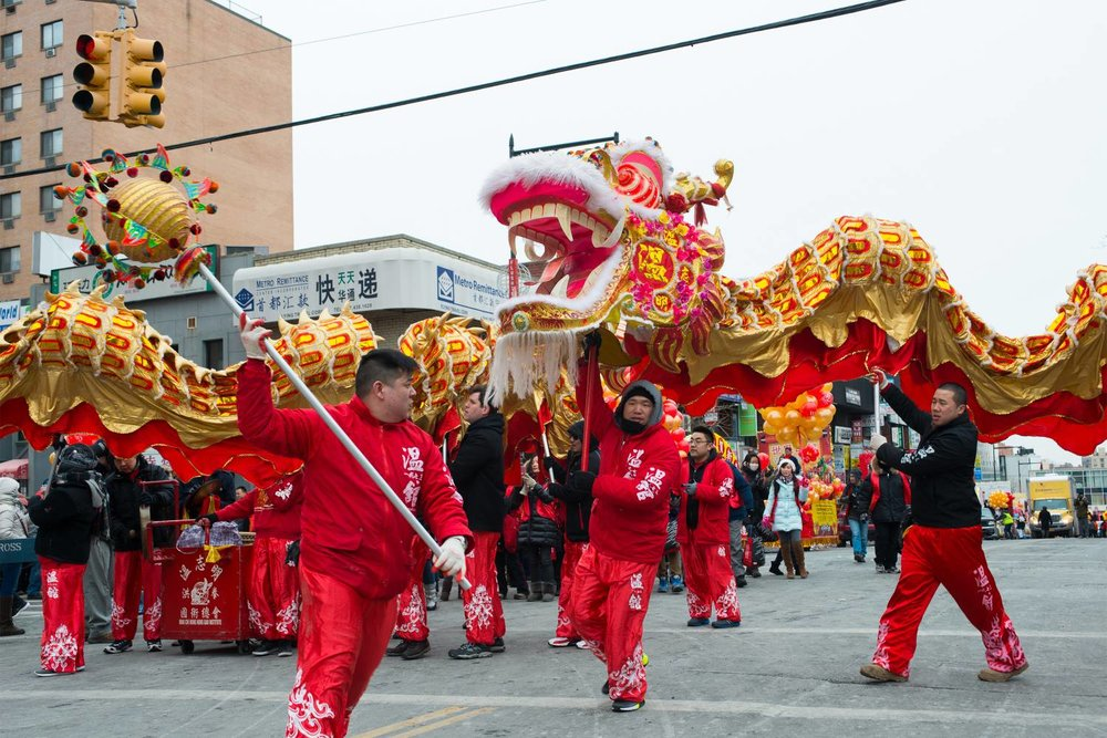 Performers march through Flushing during last year's Lunar New Year Parade. This year's parade takes place on Saturday at 11 a.m. Photo by Julienne Schaer via NYC Go