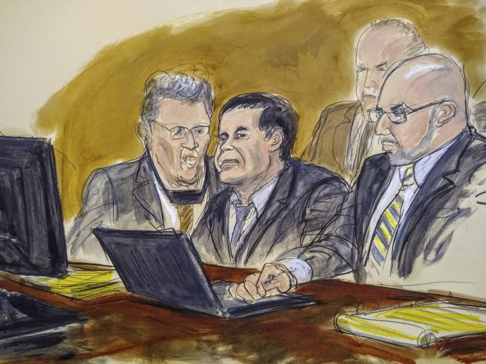 In this courtroom drawing, Joaquin El Chapo Guzman, center, listens to judge's answer to jury's question on Wednesday, Feb. 6, 2019, in New York. A jury at the U.S. trial of the infamous Mexican drug lord known as El Chapo has ended its third day of deliberations without a verdict. From left are an interpreter, Joaquin El Chapo Guzman, and attorney Eduardo Balazero. U.S. Marshals are seated behind the three men. Elizabeth Williams via AP.