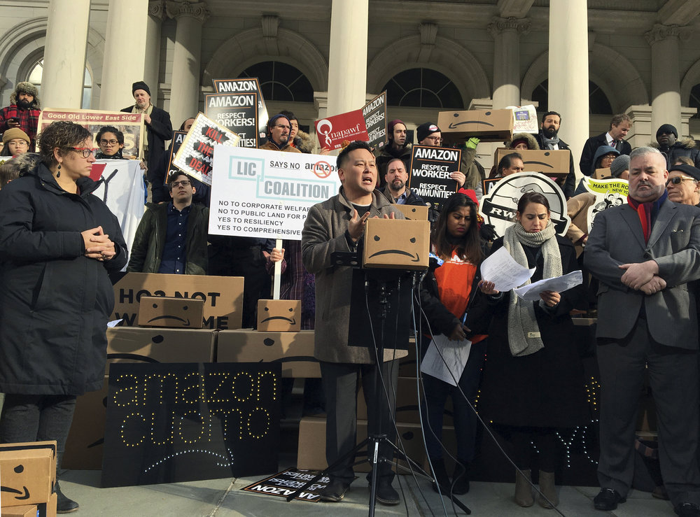 State Assemblymember Ron Kim, center, speaks at a rally opposing New York's deal with Amazon on the steps of City Hall. Kim is running for New York City Public Advocate. AP Photo/Karen Matthews.