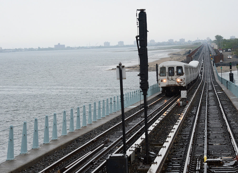 The A train makes its way from Howard Beach to the Rockaways. Photo via Marc A. Hermann / MTA New York City Transit.