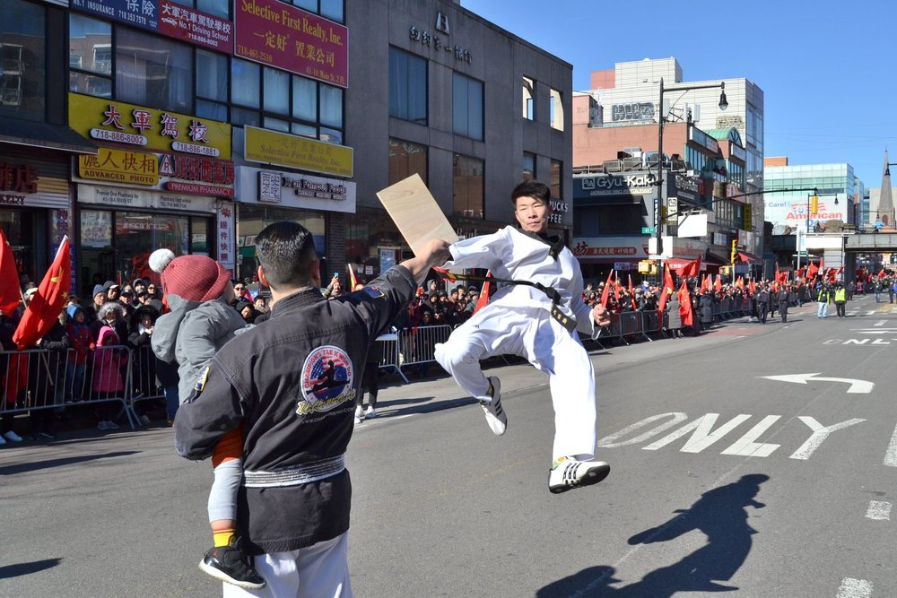 An Ultimate Champions Taekwondo student performs at Flushing's Lunar New Year Parade. Photo courtesy of Ultimate Champions Taekwondo