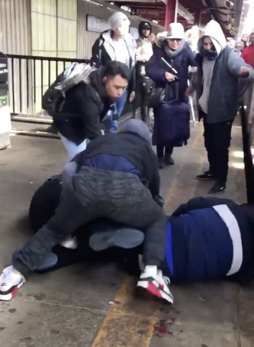 THREE MEN FOUGHT FOR A GUN ON THE PLATFORM AT 90TH STREET-ELMHURST AVENUE BEFORE ONE GRABBED IT AND SHOT A VICTIM, WHO WAS PRONOUNCED DEAD AT THE SCENE. IMAGE FROM CELLPHONE VIDEO TAKEN AT THE SCENE AND POSTED BY TWITTER USER FIRENZEMIKE.
