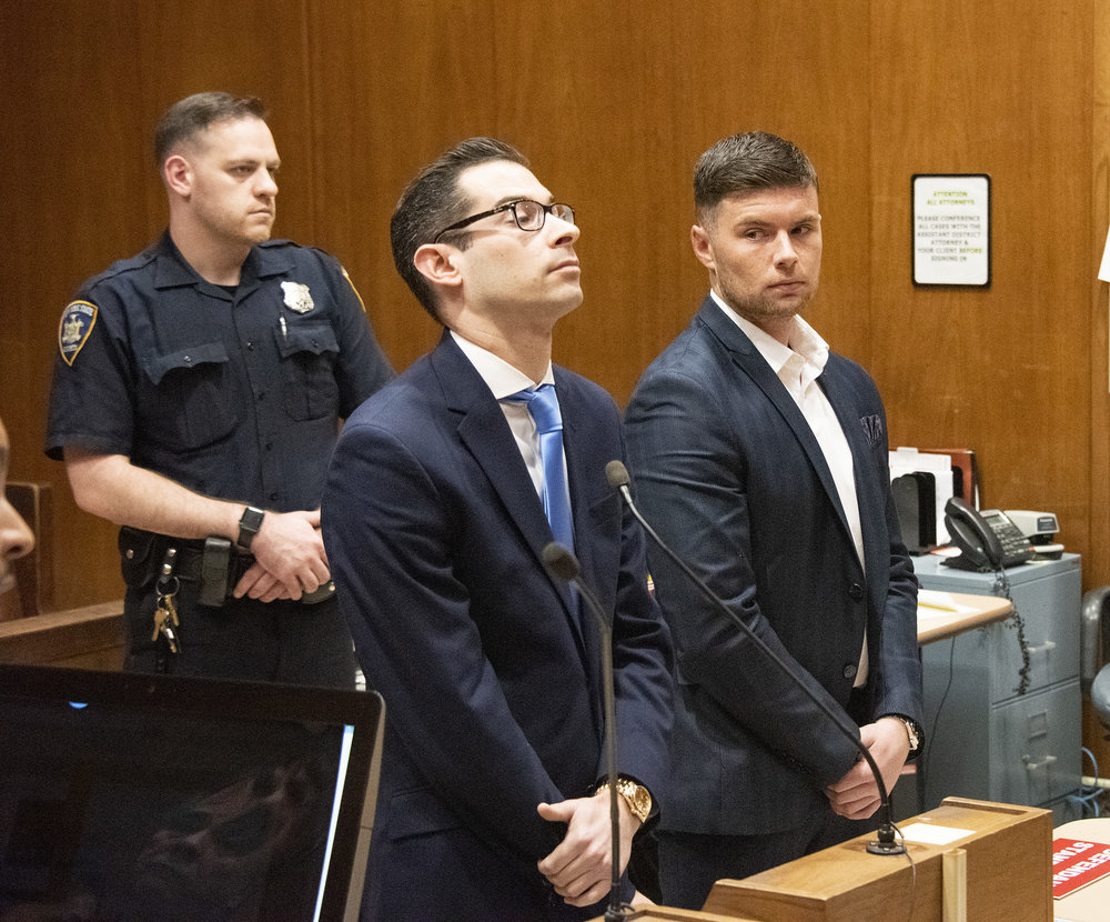 Woodside resident Steven O'Brien (right) is charged with third-degree assault for allegedly throwing the punch that killed John McGee in Sunnyside on Nov. 22. He stands with his attorney Matthew Gartenberg at a court date last month. File photo by Dennis Clark.