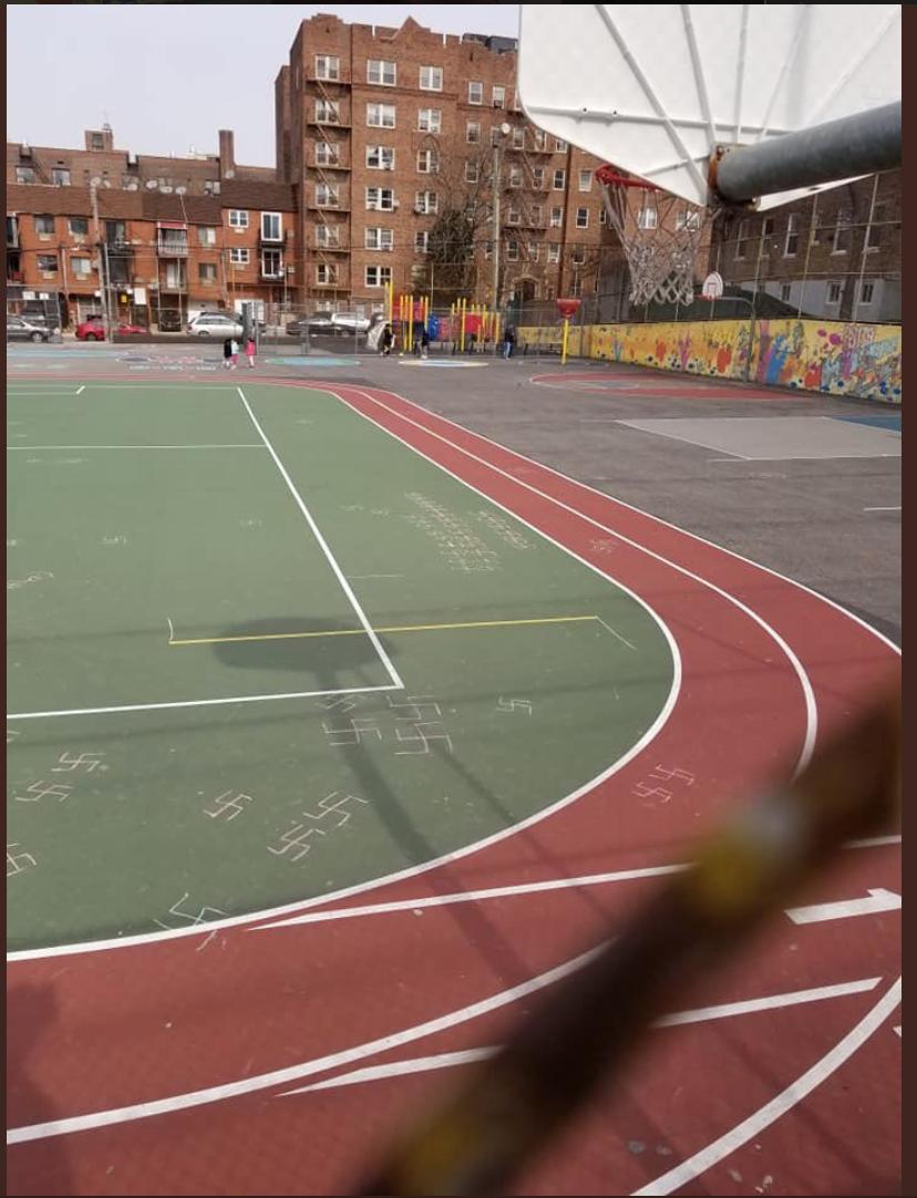 Swastikas cover the schoolyard at PS 139 in Rego Park. Photo via Councilmember Karen Koslowitz/Twitter