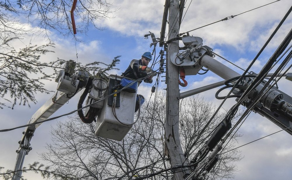 A Con Ed employees repairs a downed power line. Photo via Con Ed.