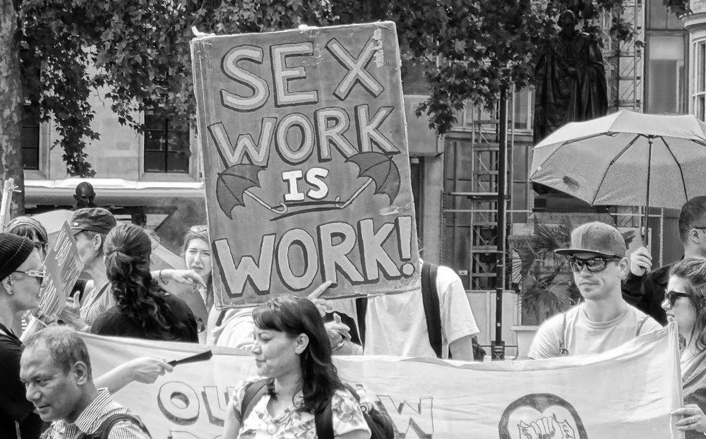 Advocates call for the legalization of sex work among consenting adults at a rally in London last year. New York state lawmakers will introduce legislation to decriminalize sex work this legislative session.  Photo by David Holt/Flickr