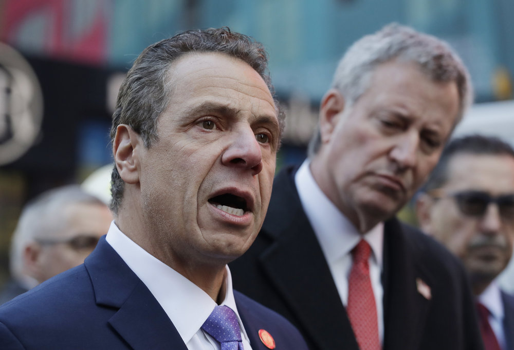 Andrew Cuomo, left, and Mayor Bill de Blasio attend a news conference together in 2017. (AP Photo/Mark Lennihan).