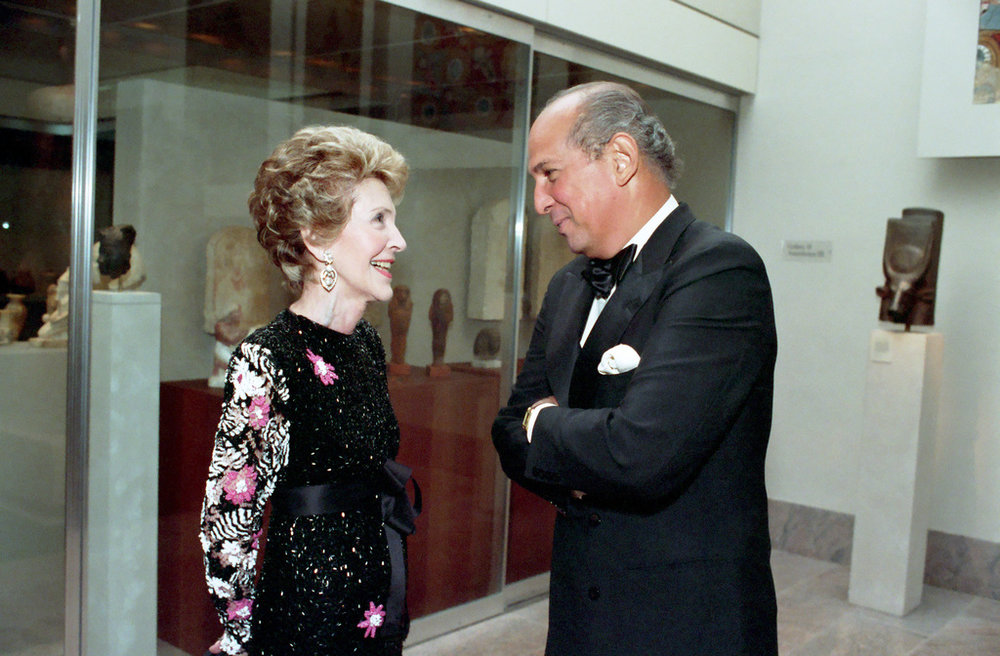 A Queens Supreme Court Civil Term jury awarded a woman more than $30,000 in damages in a 2016 racial discrimination lawsuit decision against the fashion brand founded by Oscar De La Renta (pictured with First Lady Nancy Reagan in 1988). The Second Department upheld that decision this week. Photo via the U.S. National Archives.