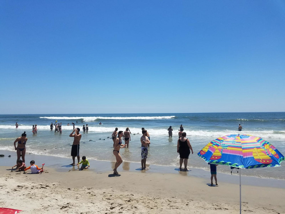 Swimmers and sunbathers pack Rockaway Beach. Photo by Zach Hoffman.