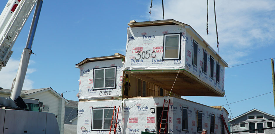 Final section of a Build It Back modular home lowered into place in Broad Channel. Photo via NYC.gov.