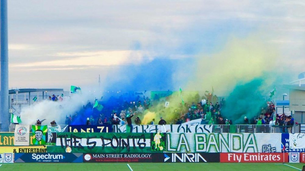 The Cosmos' 5 Points supporters celebrates their beloved club. Photos courtesy of Nicholas Alexandrakos