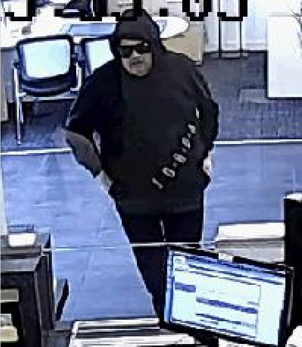 Surveillance images of a suspect wanted for robbing a Middle Village bank.