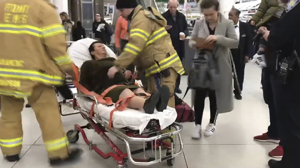 In a still image taken from video provided by WNBC-TV News 4 New York, emergency medical personnel tend to an injured passenger from a Turkish Airlines flight at John F. Kennedy International Airport on Saturday. Officials say severe turbulence injured at least 30 people aboard a Turkish Airlines flight from Istanbul that landed safely at New York's Kennedy International Airport on Saturday. Photos courtesy of WNBC-TV News 4 New York via AP.