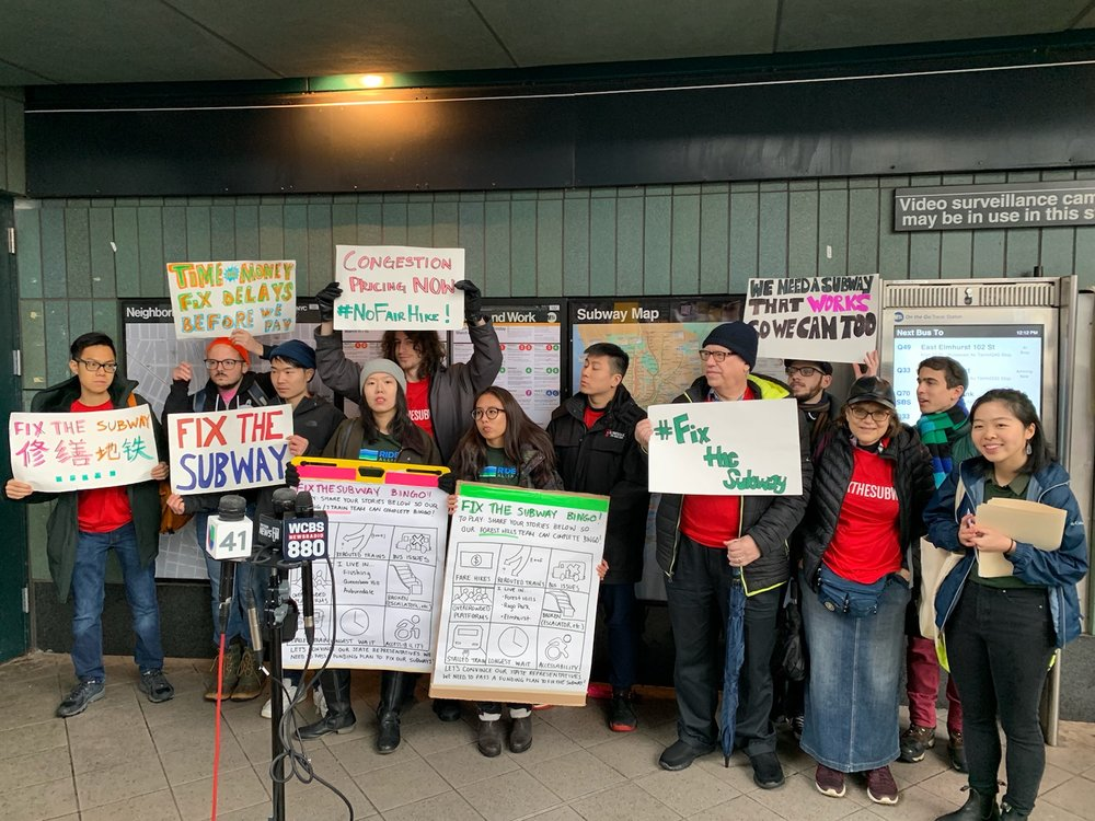 """Commuters from Riders Alliance rally in support of congestion pricing at """"#FixTheSubway BINGO"""" in Jackson Heights on March 10. Photos courtesy of Riders Alliance."""