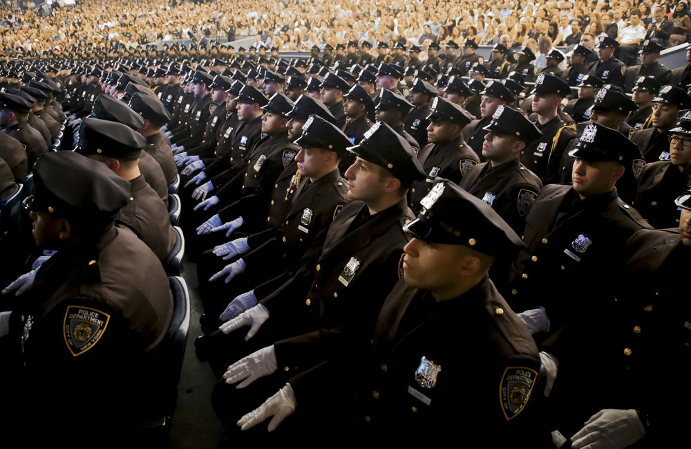A new class of NYPD officers graduates from the Police Academy. AP Photo