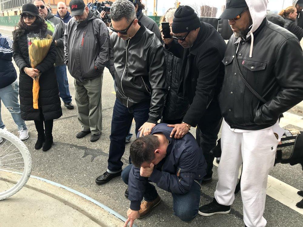 Michael Vega cries during the vigil for Robert Spencer.