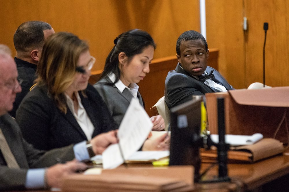 Chanel Lewis (right) glances into the gallery during opening statements in his murder retrial. Lewis is charged with first-degree murder for allegedly killing Karina Vetrano near her Howard Beach home. Pool photo by Uli Seit.