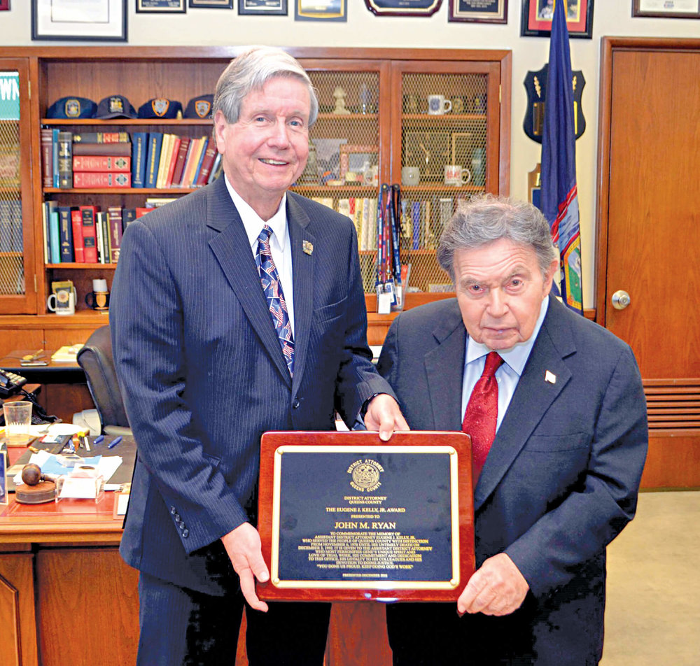 Chief Assistant District Attorney John Ryan receives an award from Queens DA Richard Brown in 2016. Photo courtesy of the Queens DA's Office