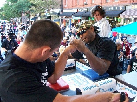 Armed and dangerous: Arm wrestling competitors grapple for last year's title. The 2019 championships are Sunday. Photo courtesy of the Queens Tourism Council.