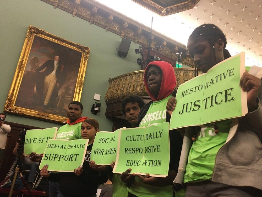 Students from the Urban Youth Collaborative demonstrate at a budget hearing in City Hall. Photo courtesy of Charlotte Pope