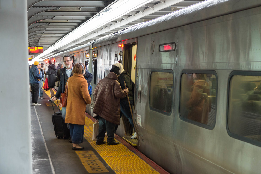 Riders board a train at the Jamaica LIRR station.  Eagle  photos by Jonathan Sperling.