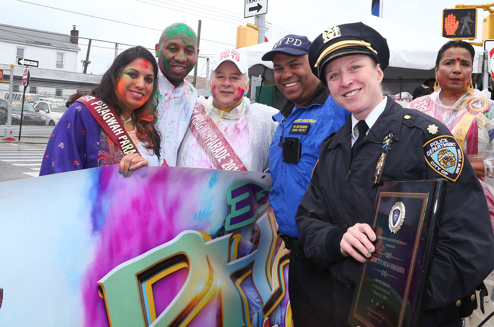 Parade organizers present a plague and donation in honor of late NYPD Detective Brian Simonsen. From left, the Hon. Karen Gopee, Councilmember Donovan Richards, the Hon. Greg Lasak, NYPD Community Affairs PO Jose Severino, NYPD Deputy Inspector Courtney Nilan and Parade co-chair Vedo Basdeo.