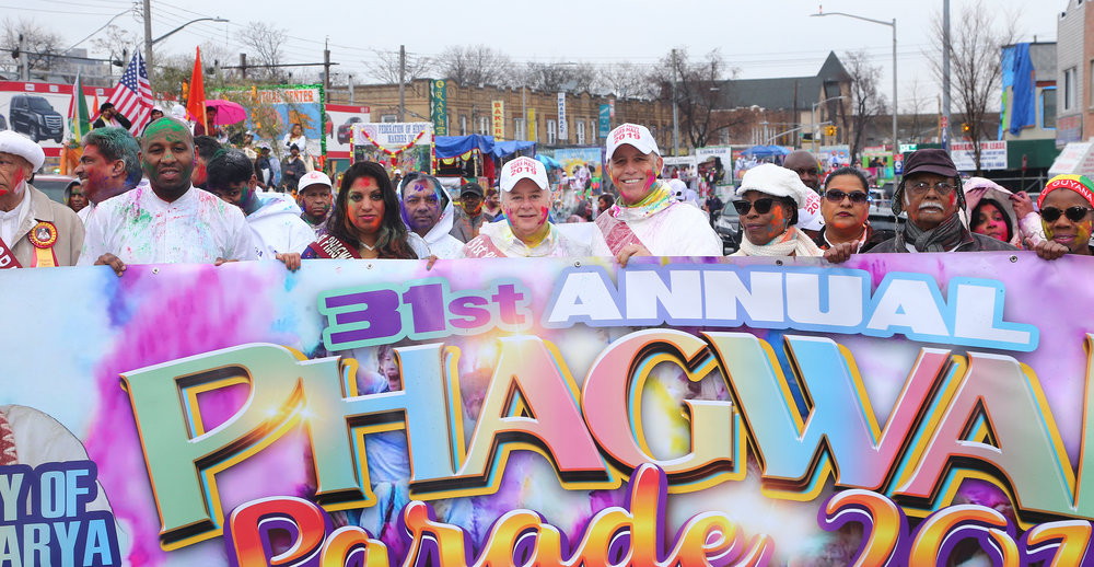 From left, Councilmember Donovan Richards, the Hon. Karen Gopee, the Hon. Gregory Lasak, attorney Todd Greenberg and the Guayanese Consul General Barbara Atherly hold the Phagwah Parade banner.