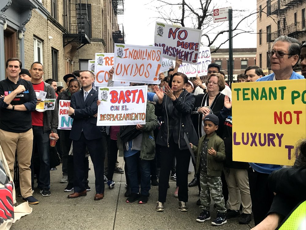 Ridgewood residents join elected officials to condemn landlord abuse and harassment. State Sen. Michael Gianaris (left) Assemblymember Brian Barnwell (second from left), U.S. Rep. Nydia Velasquez (third from left) and Assemblymember Cathy Nolan (fourth from left) observe a speaker.