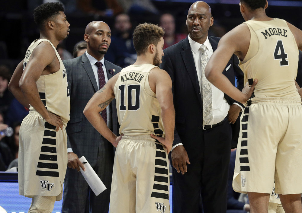 Former Wake Forest assistant coach Jamill Jones, second from left, with the team and head coach Danny Manning, second from right, during the second half of an NCAA basketball game. Prosecutors says Jones threw a punch that killed a tourist in Long Island City. AP Photo by Chuck Burton.