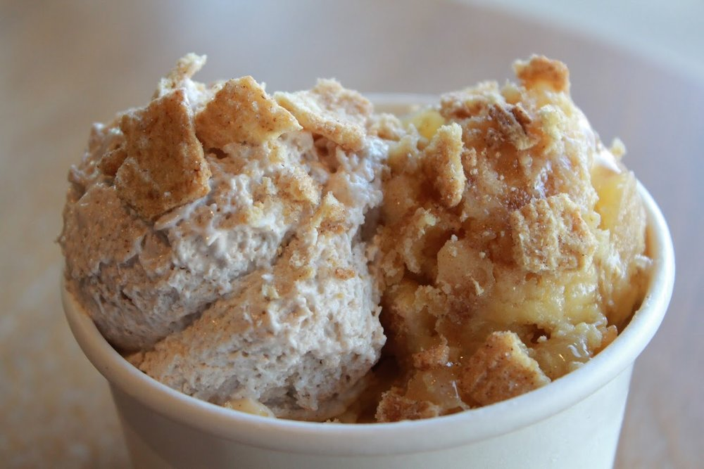 the big apple - -two scoops vanilla ice cream--one scoop apple cobbler--one scoop snickerdoodle mousse-topped with cinnamon toast crunch