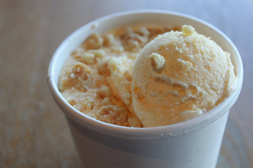 the basic - -vanilla mousse shake--topped with a scoop of vanilla ice cream-garnished with cake mix
