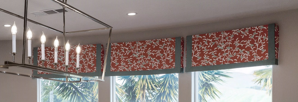 Tailored valances with custom details on a curved wall! What a showcase!