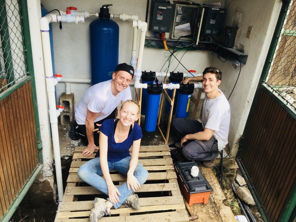 Students working on the water filtration system at the Common Hope campus in Antigua.
