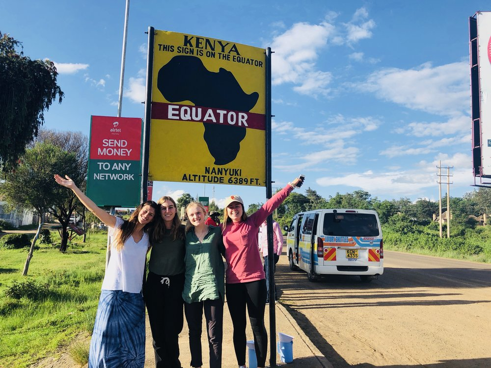 Students on the May 2018 Kenya project assessment trip crossing the equator.